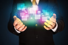 Man holding abstract icons Stock Images