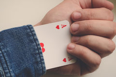 Man holding an ace in sleeve. Man holding an ace card in sleeve Stock Photo