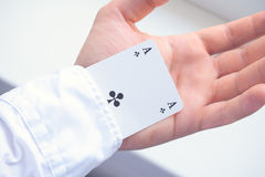 Man holding an ace in sleeve. Man holding an ace card in sleeve Royalty Free Stock Photos