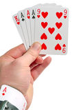 Man holding ace in a sleeve while playing poker. Cheating in poker with ace in sleeve Royalty Free Stock Photos