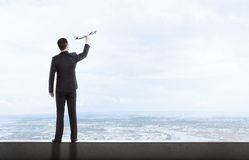 Man holding airplane royalty free stock photo