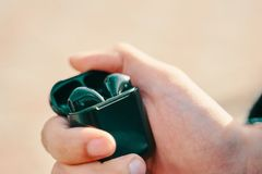 Free Man Holding Airpods Royalty Free Stock Images - 162746269