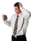 Man Holding an Alarm Clock Royalty Free Stock Image