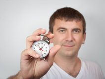 Man holding alarm clock Royalty Free Stock Image
