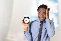 Man holding an alarm clock Royalty Free Stock Photography