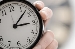 Man holding alarm clock close up Royalty Free Stock Photography