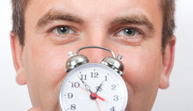 Man holding alarm clock Royalty Free Stock Images