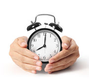 Man holding alarm clock in hands. Man holding alarm clock in the hands Stock Photography