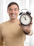 Man holding alarm clock Stock Photography