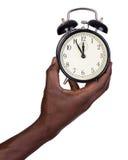 Man holding alarm clock Royalty Free Stock Photos