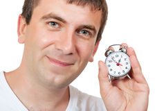 Man holding a alarm clock Stock Photos