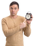 Man holding an alarm clock. Portrait of young caucasian man holding an alarm clock Stock Images