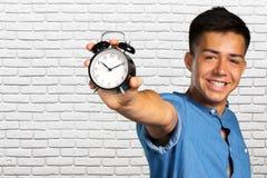 Man holding an alarm clock Stock Photos