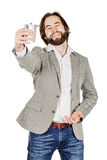 Man holding alcohol flask Royalty Free Stock Images