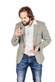 Man holding alcohol flask Stock Images