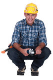 Man holding angle-grinder Royalty Free Stock Photography