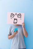 Man holding angry expression billboard. And take phone isolated on blue background Stock Images