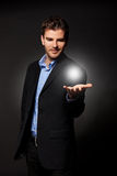 Man holding the answer to all. Young casual business man holding the answer to all the problems stock photos