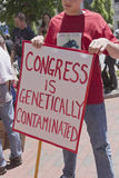Man Holding Anti GMO Rally Sign in Asheville Royalty Free Stock Image
