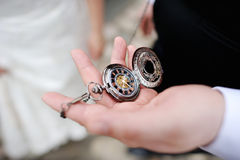 A man holding an antique pocketwatch Royalty Free Stock Images