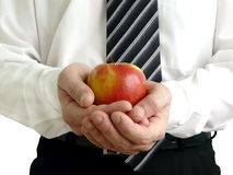 Man holding apple in hands. Man with apple holding in hand Stock Photo