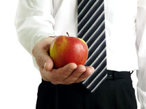 Man holding apple in hands Royalty Free Stock Photos