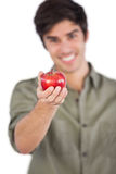 Man holding apple on his hand Stock Photo