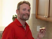 Man Holding an Apple Slice stock photos