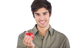 Man holding an apple Stock Photos