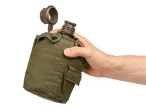 Man holding army water cantee Stock Image