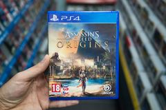 Man holding Assassin`s creed Origins videogame Royalty Free Stock Image