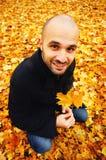 Man holding autumn leaf Stock Images