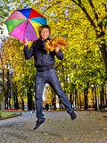 Man holding  autumn umbrella Royalty Free Stock Photography