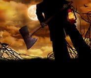 Man holding ax and lantern Stock Photo