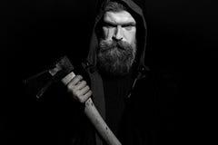 Man holding ax stock photography