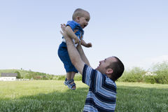 Man holding a baby boy Stock Image