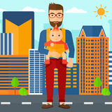 Man holding baby in sling. Royalty Free Stock Images