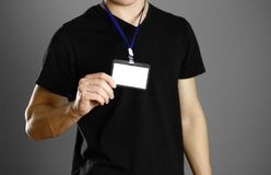 Man holding a badge. Close up. Isolated background royalty free stock image