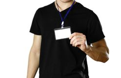 Man holding a badge. Close up. Isolated background royalty free stock images