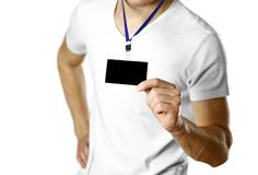 Man holding a badge. Close up. Isolated background stock photo