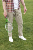 Man holding badminton racquet and shuttlecock and ready to play Stock Photos