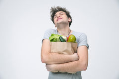 Man holding a bag full of groceries Stock Photography