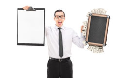 Man holding a bag full of money and a clipboard Royalty Free Stock Photo