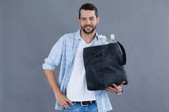 Man holding a bag full of plastic bottles Royalty Free Stock Photography
