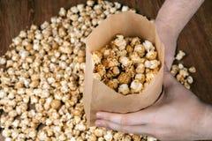Man holding a bag of popcorn. Close up Stock Photos