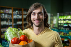 Man holding bag of vegetables Stock Image