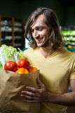 Man holding bag of vegetables Royalty Free Stock Images