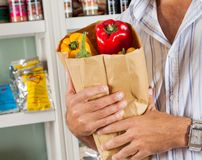 Man Holding Bag Of Vegetables In Store Royalty Free Stock Image