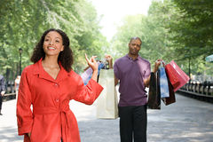 Man holding bags for woman Royalty Free Stock Images