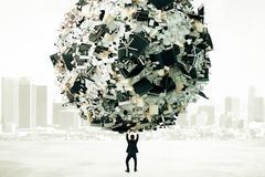 Man holding a ball of heap of papers and other office st Stock Photography